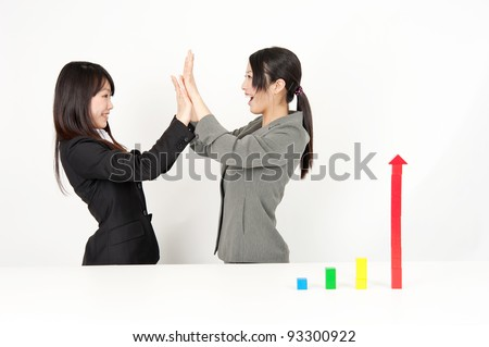 successful asian businesswomen with bar graph made of building block - stock photo