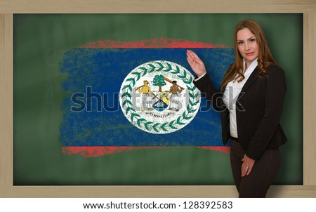 Successful, beautiful and confident woman showing flag of belize on blackboard for marketing research, presentation and tourist advertising - stock photo
