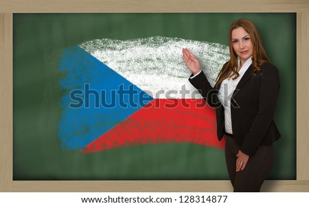 Successful, beautiful and confident woman showing flag of czech on blackboard for marketing research, presentation and tourist advertising - stock photo