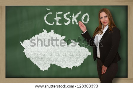 Successful, beautiful and confident young woman showing map of czech on blackboard for presentation, marketing research and tourist advertising - stock photo