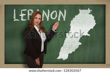 Successful, beautiful and confident young woman showing map of lebanon on blackboard for presentation, marketing research and tourist advertising - stock photo