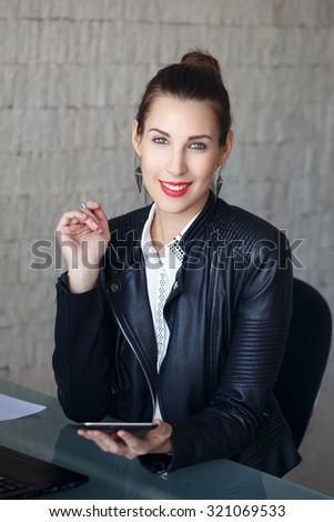 Successful brunette modern businesswoman teeth smile in office - stock photo