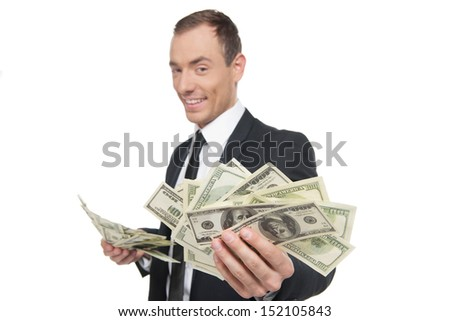 Successful buinessman. Happy young man in formalwear showing money while standing isolated on white - stock photo