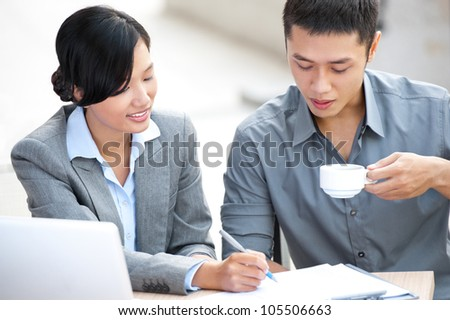 Successful business colleagues sitting in office and planning work together - stock photo