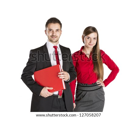 Successful business couple is standing on isolated background. - stock photo