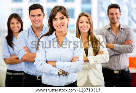 Successful business group smiling at the office - stock photo