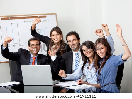Successful business group with laptop at the office - stock photo