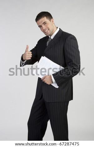 Successful business man gesturing a thumbs up sign on white - stock photo