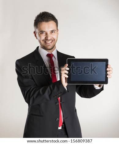 Successful business man is posing in studio - stock photo