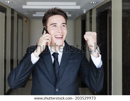 Successful business man on the phone. Success business concept. - stock photo