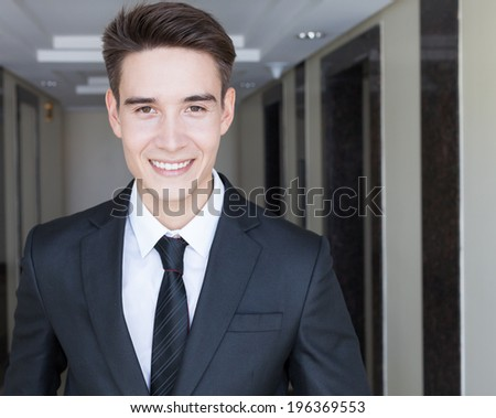 Successful business man smiling. - stock photo
