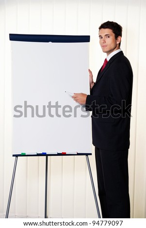 successful business man with a flip chart in a presentation - stock photo