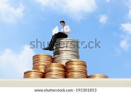 Successful business man working on growth money stairs coin with sky - stock photo