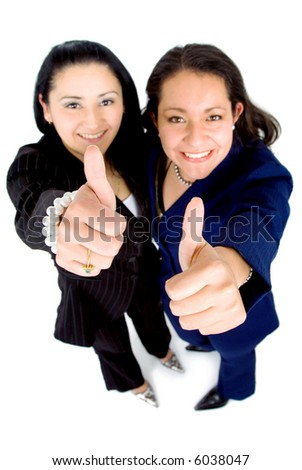 successful business partnership - two businesswomen doing the thumbs up sign isolated over a white background - stock photo