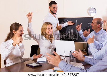 Successful business people during conference call indoors - stock photo