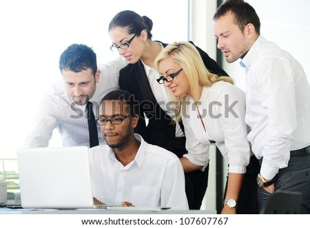 Successful business people having discussion at office - stock photo