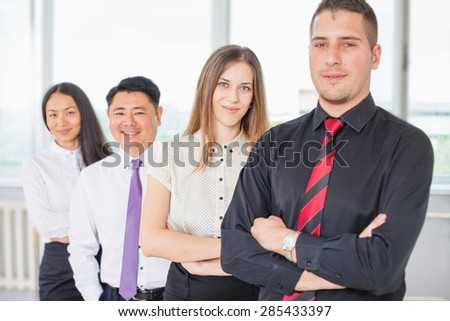 Successful business people or business team of women and man at background. Image symbolizes a successful corporation or company, achieve success for intelligent and handsome men and women - stock photo