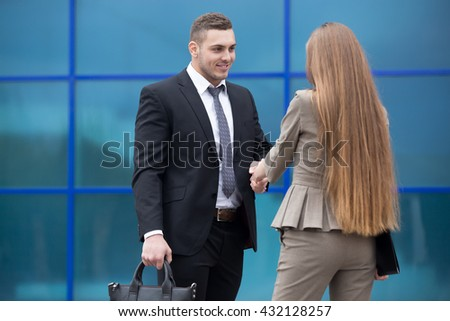 Successful business people shaking hands for greeting or in agreement happy to work together. Focus on smiling businessman. Successful Deal Concept. Businesspeople Teamwork - stock photo