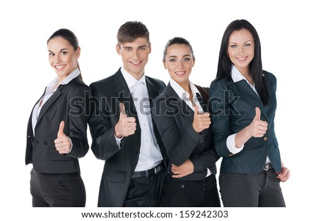 Successful business people with thumbs up and smiling. Standing isolated on white  - stock photo
