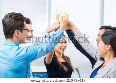 Successful business team clinking glasses - stock photo