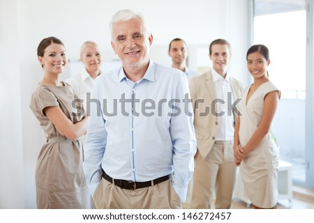 Successful business team in their modern office. - stock photo