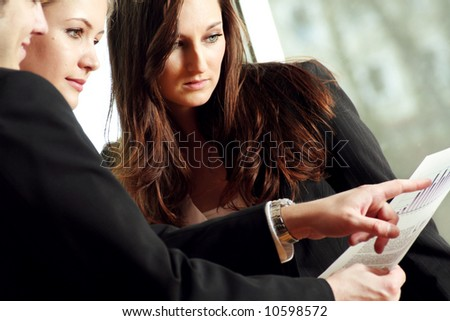 successful business team is talking about some worksheets - stock photo