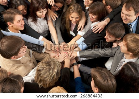 Successful Business Team Joining Hands Together - stock photo