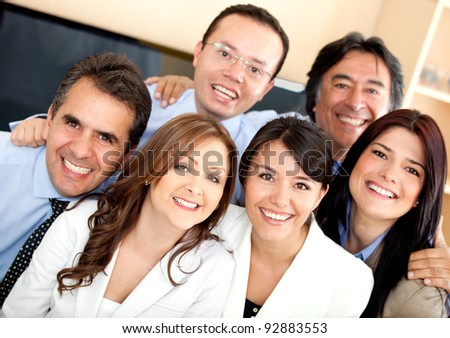 Successful business team looking happy at the office - stock photo