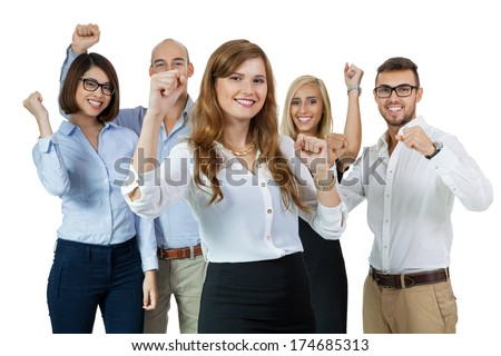 Successful business team of diverse young executives standing cheering and celebrating their success with an attractive young businesswoman or team leader in the foreground, on white - stock photo