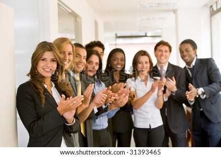 Successful business team smiling in an office - stock photo