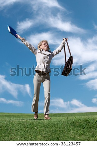 Successful business woman against the nature - stock photo