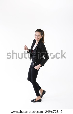 Successful business woman celebrating and dancing for joy. Caucasian brunette female model. Isolated on white background. - stock photo