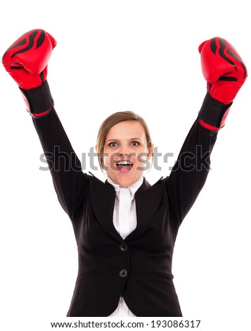 Successful business woman celebrating with arms in air wearing boxing gloves - business concept-isolated over white background - stock photo