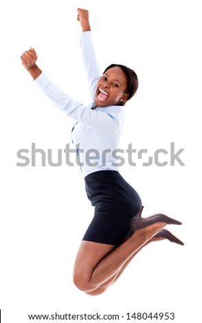 Successful business woman jumping with arms up - isolated over white  - stock photo