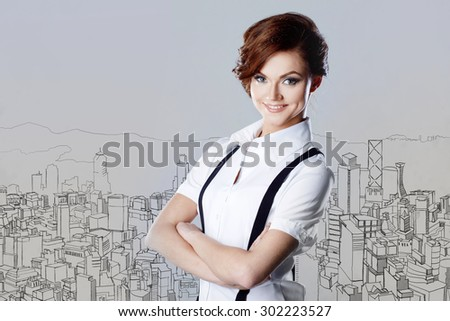 Successful business woman, on the background of a sketch urban landscape - stock photo