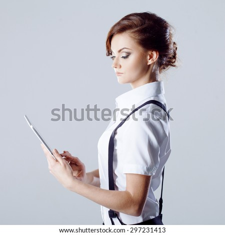 Successful business woman, on white background, with laptop in hand - stock photo