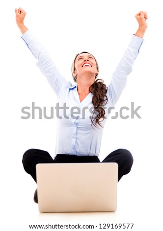 Successful business woman with a laptop - isolated over a white background - stock photo