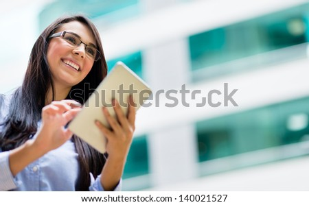 Successful business woman with a tablet computer - stock photo