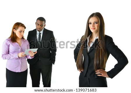 Successful Business Woman with Arms on Side and Her Team with Different Poses - stock photo
