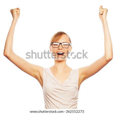 Successful business woman with arms up - stock photo