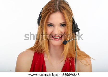 Successful business woman working - she using headphone and computer, happy girl. - stock photo