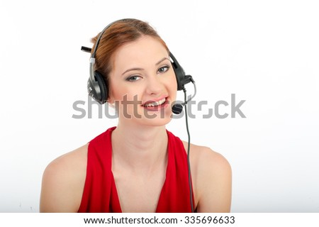 Successful business woman working - she using headphone and computer, smiling - stock photo