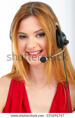 Successful business woman working - she using headphone and computer - smiling - stock photo