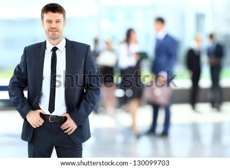 Successful businessman at the office - stock photo