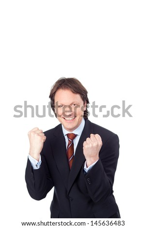 successful businessman balling his fists against white background - stock photo
