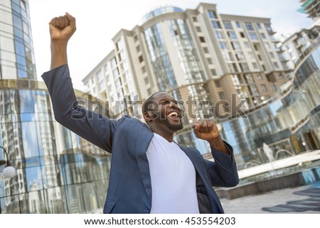 Successful businessman celebrating his victory - stock photo