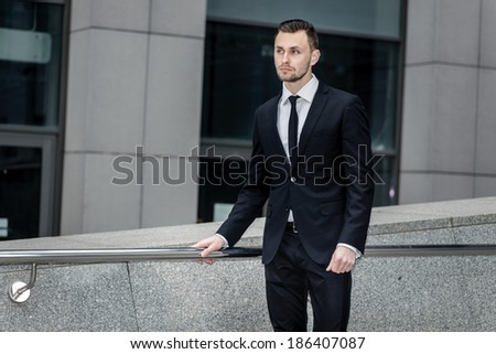 Successful Businessman. Confident young men standing near his of - stock photo