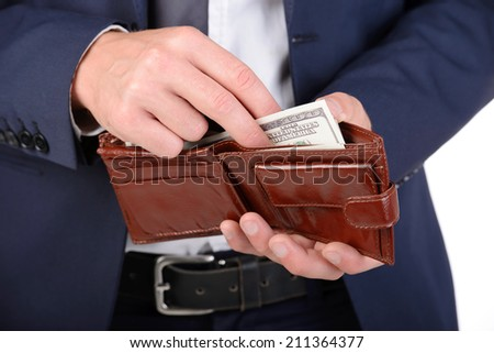 Successful businessman holding a wallet with American money. - stock photo