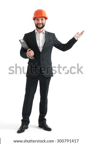 successful businessman in formal wear and orange helmet pointing his hand at something. isolated on white background - stock photo