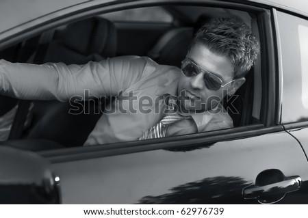 Successful businessman in the car - stock photo